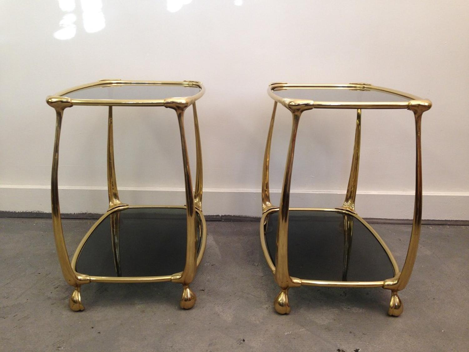 A pair of gilt metal and glass side tables
