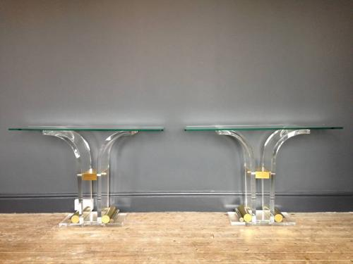 A pair of gilt brass and lucite console tables