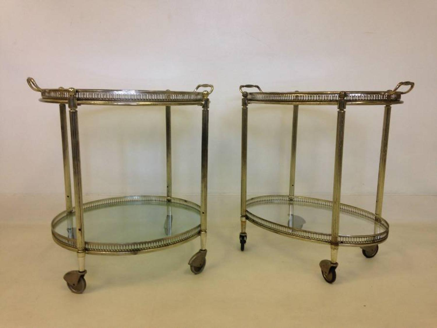 A pair of French silvered trolleys