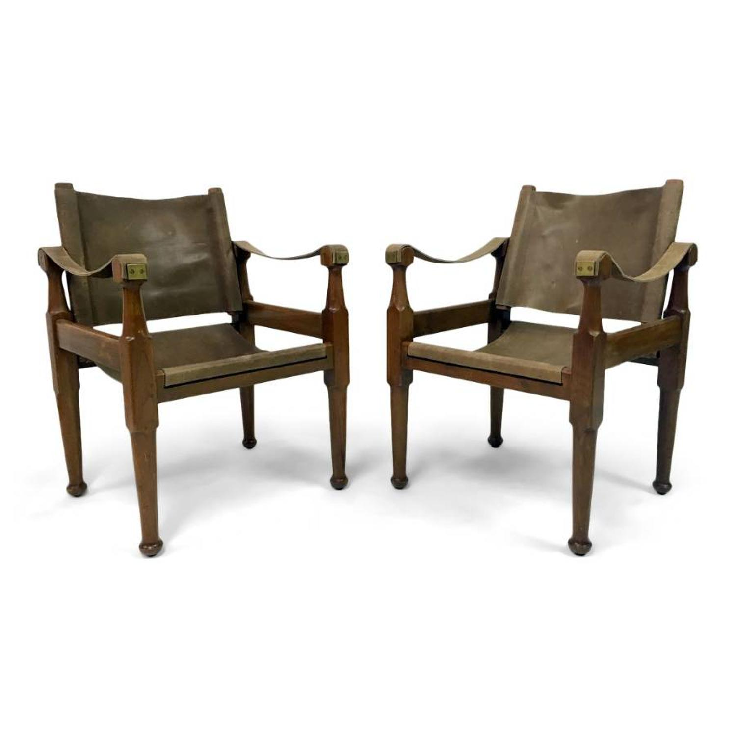 A pair of brown leather safari chairs