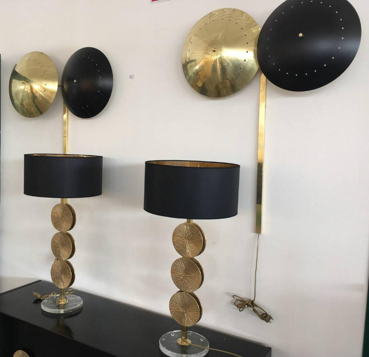 A pair of brass and black wall lamps