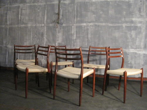 Six rosewood and cord chairs by Niels Moller