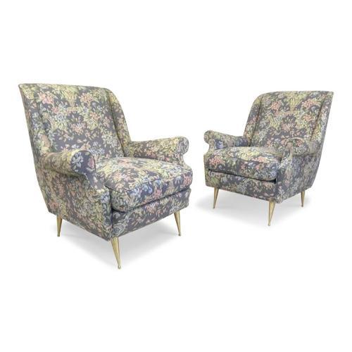 A pair of 1960s Italian armchairs on brass legs
