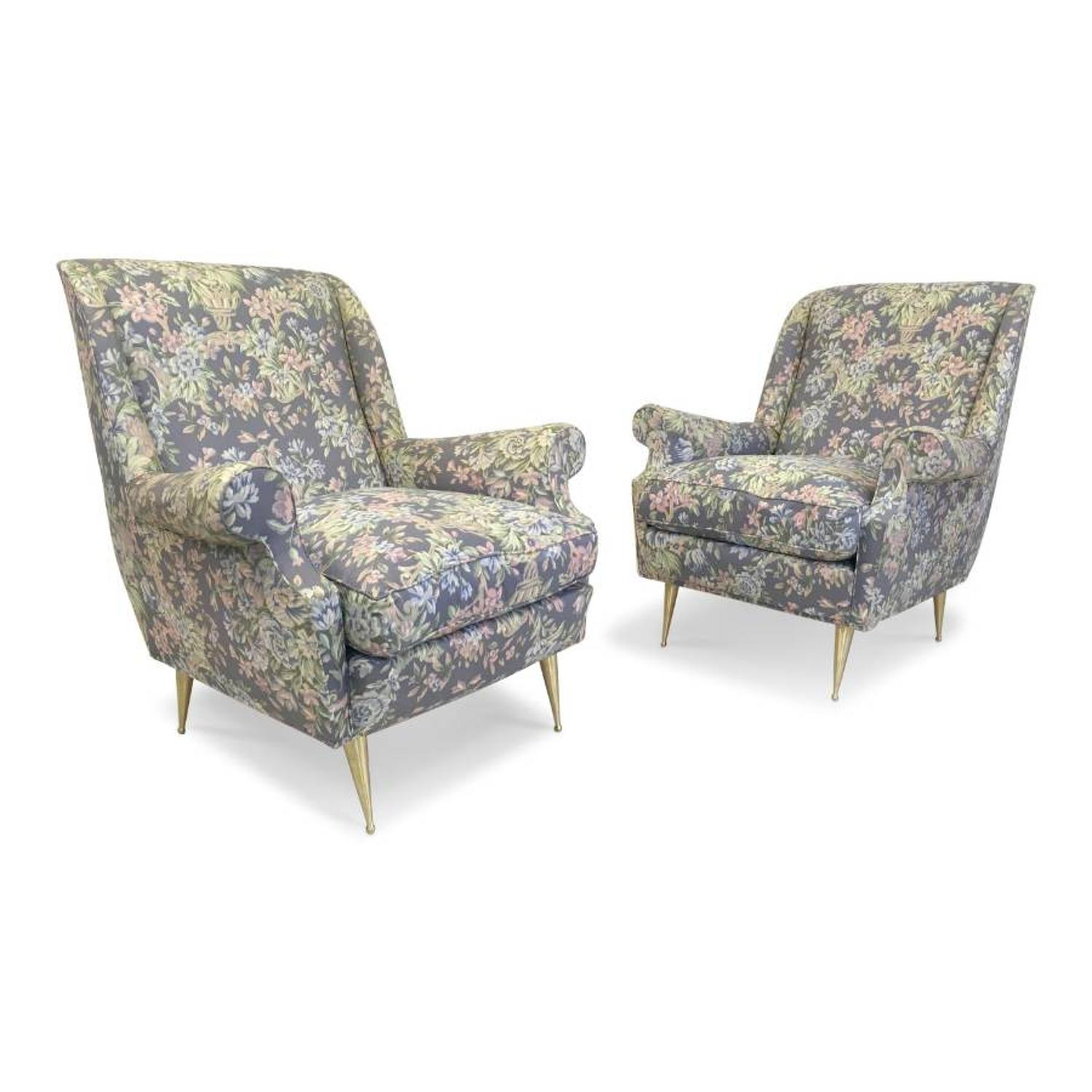 A pair of 1960s Italian armchairs on brass legs