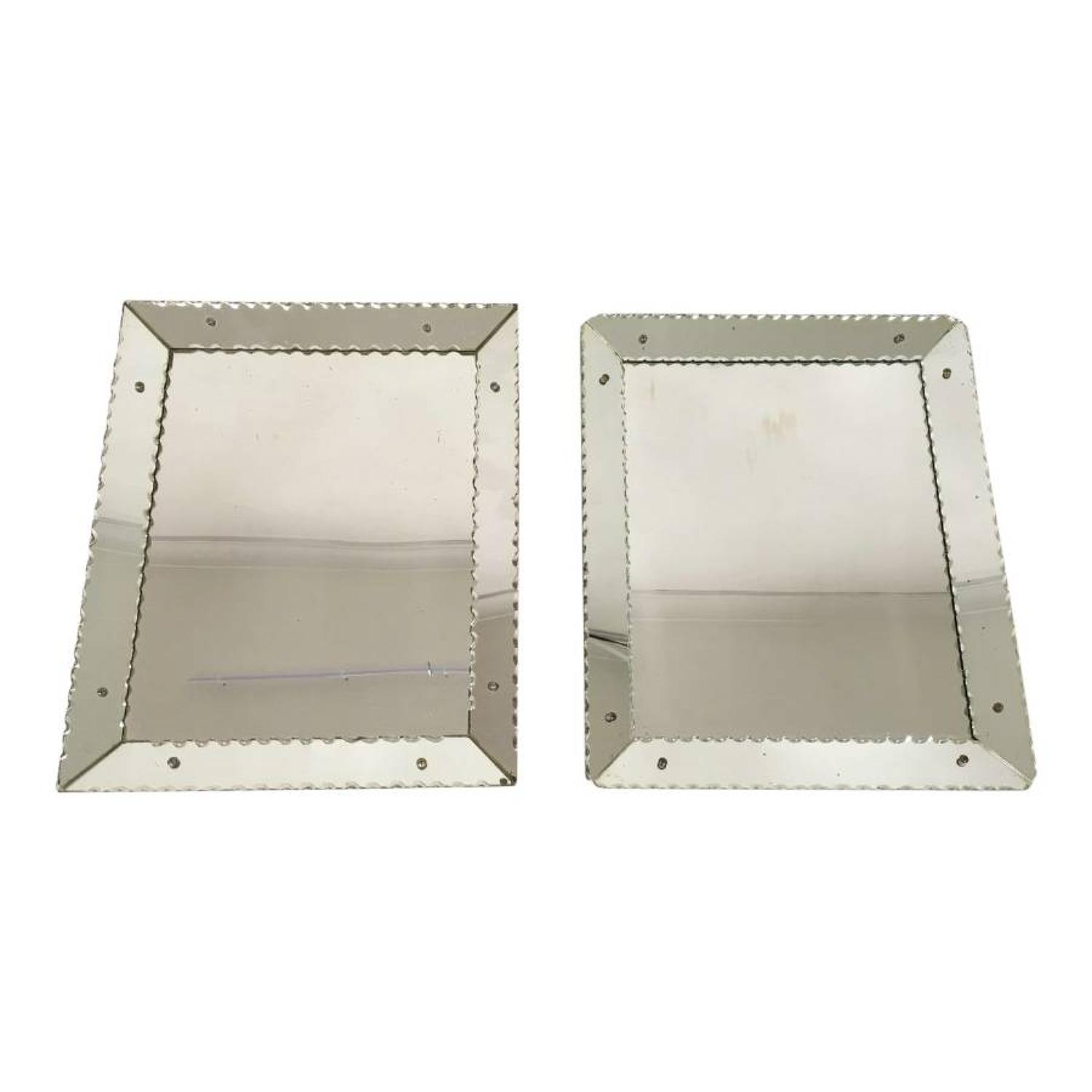 A matched pair of cushion scalloped edge mirrors