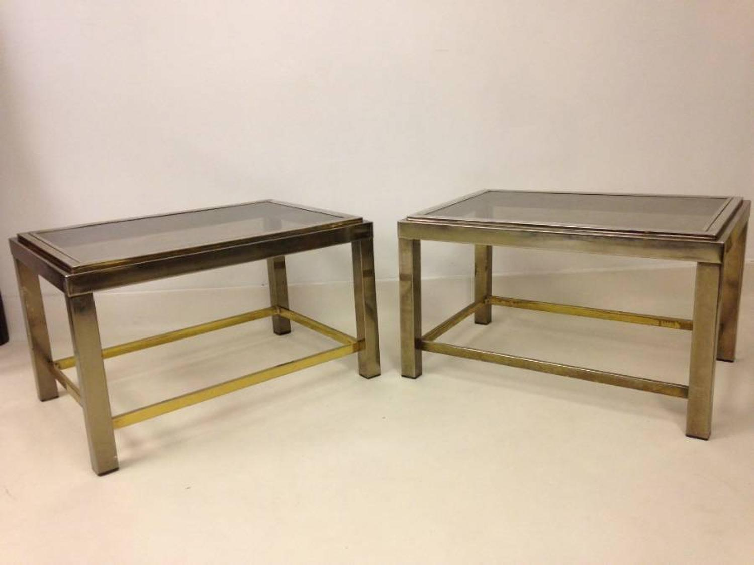 A pair of two tier chrome side tables