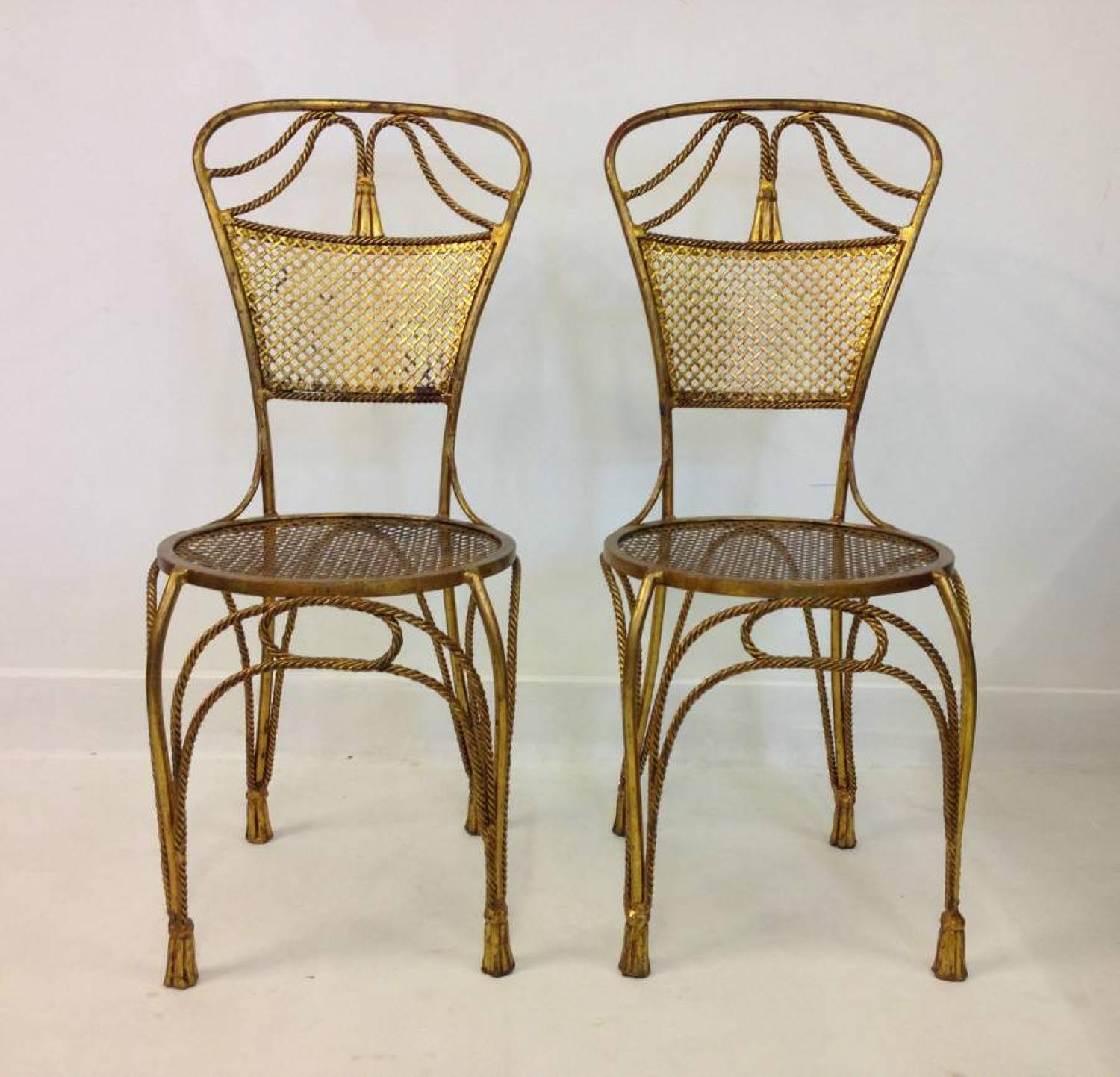 A pair of gilt metal rope or tassel chairs