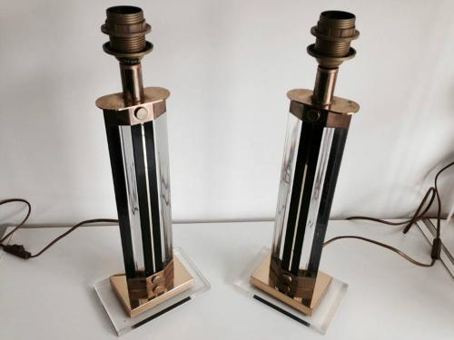 A pair of lucite and brass table lamps