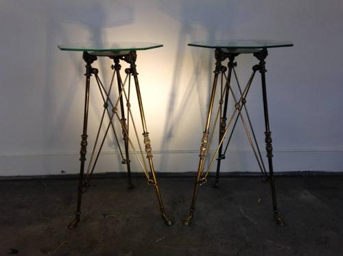 A pair of antique brass gueridons