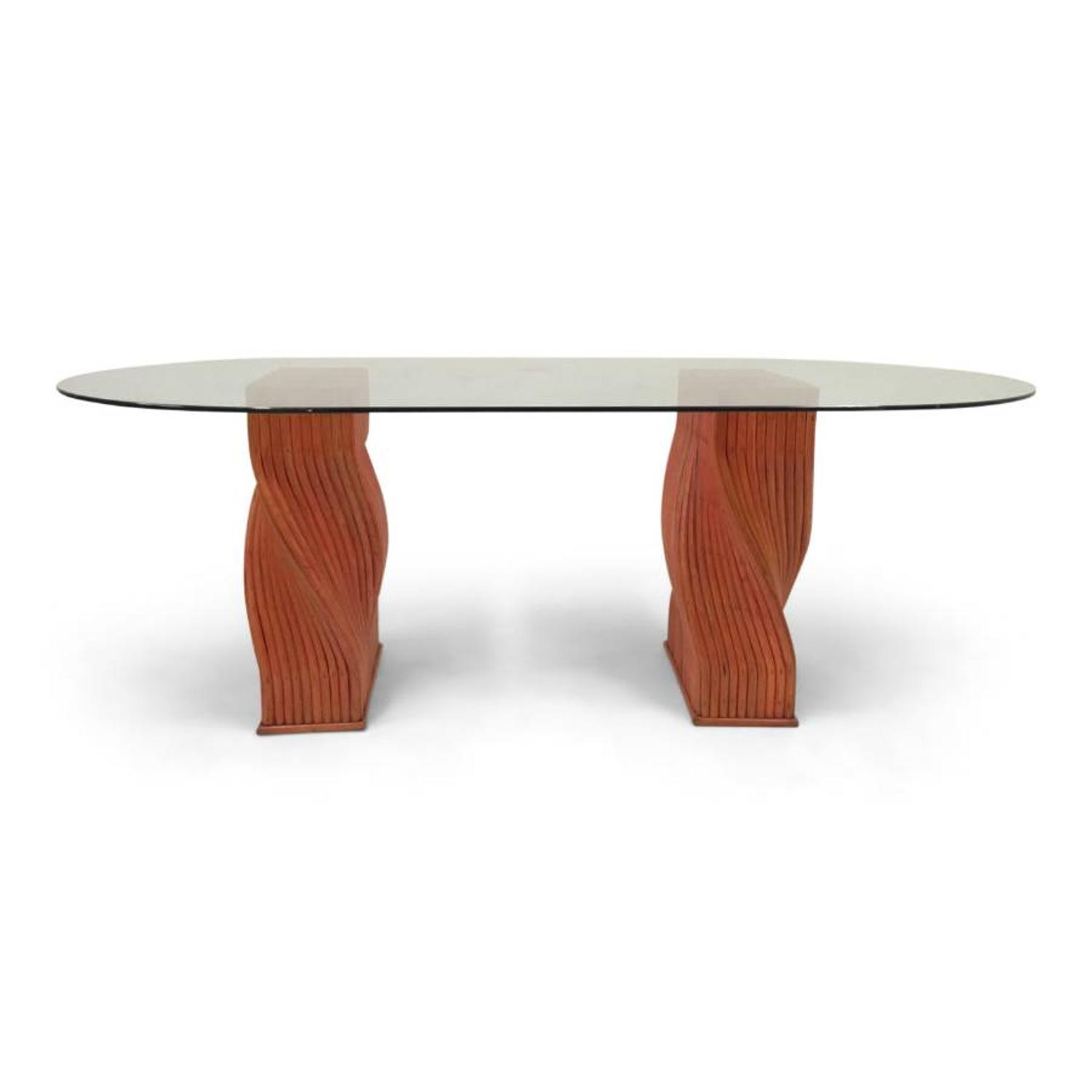 A red bamboo and glass dining table