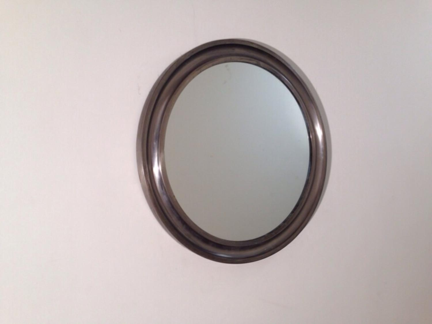Round metal framed mirror