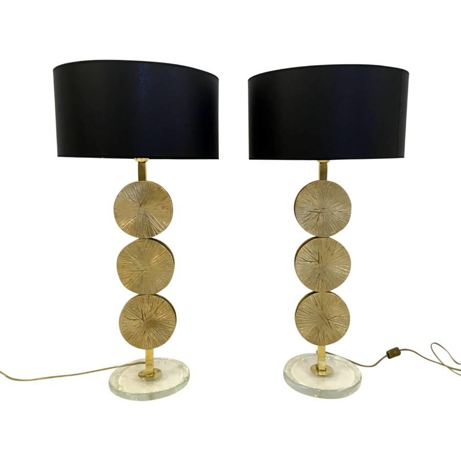 A pair of brass and murano glass table lamps