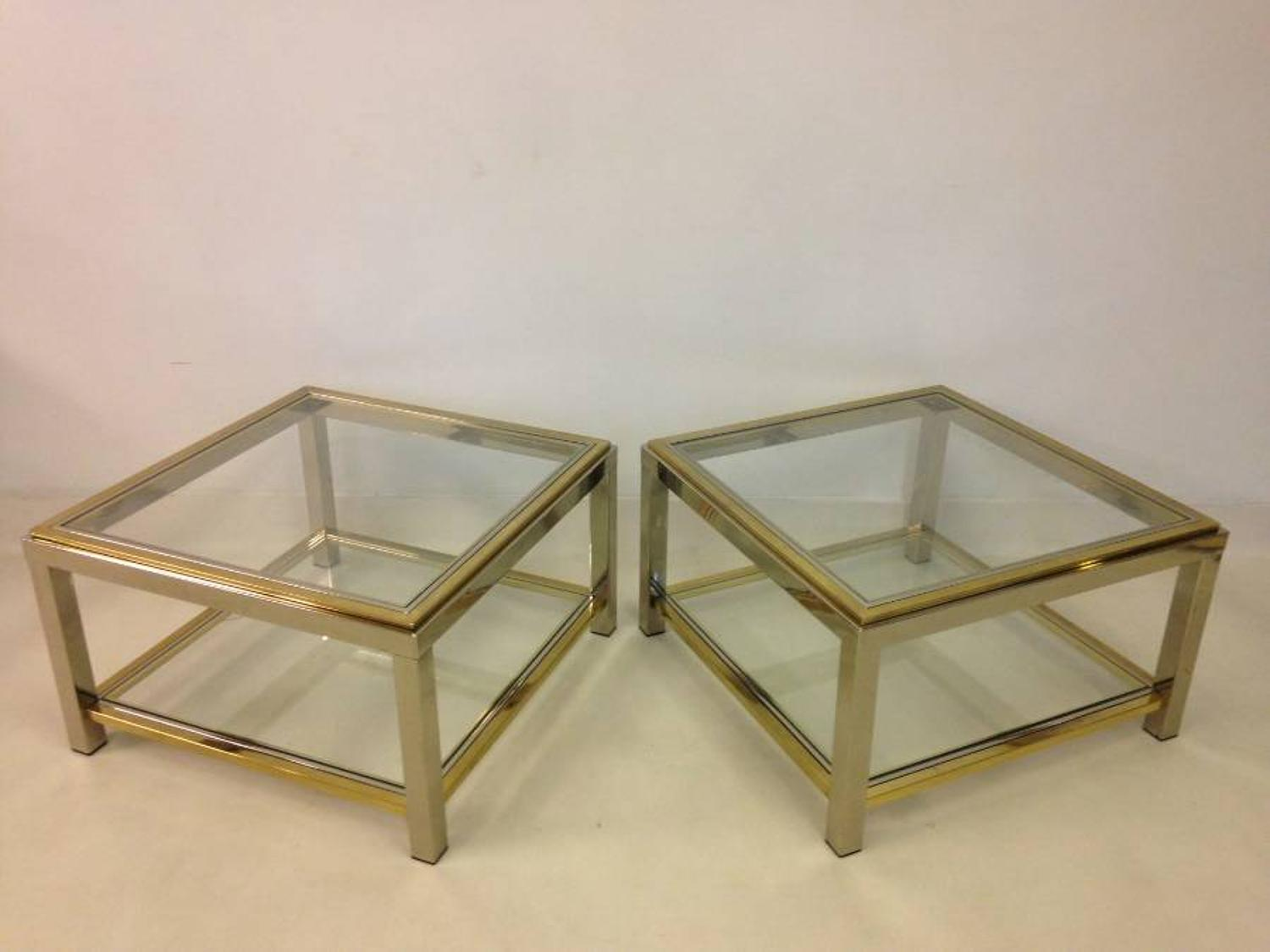 A pair of steel and gold metal side tables