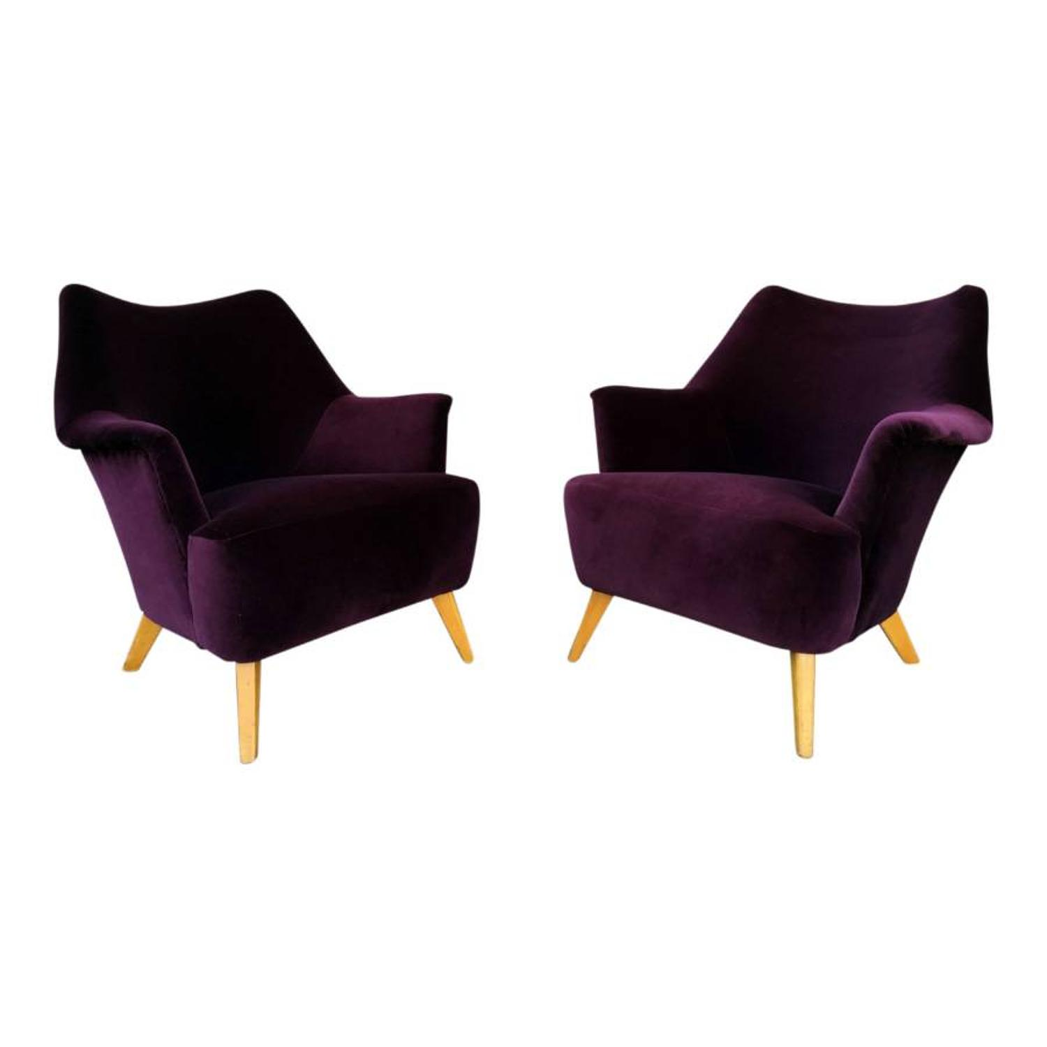 A pair of 1950s armchairs in new plum velvet