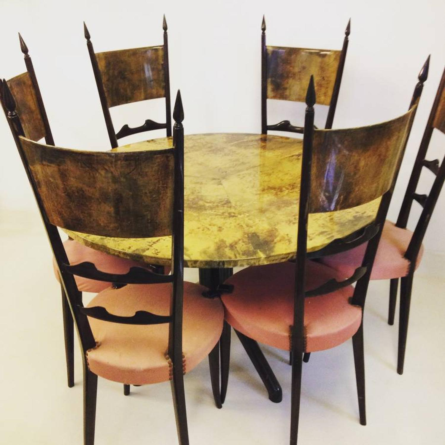 Dining table and six chairs by Aldo Tura