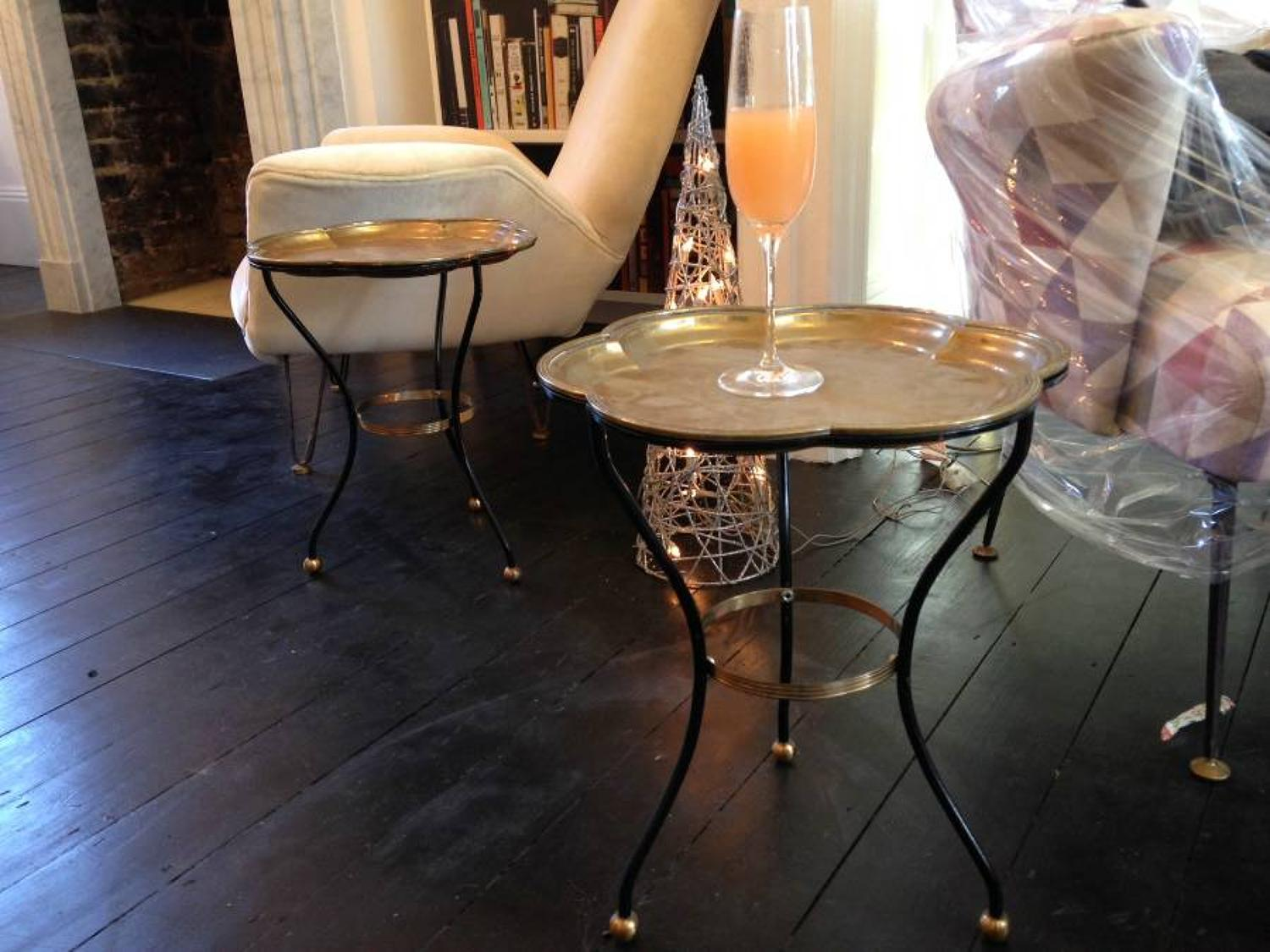 A pair of brass tray side tables