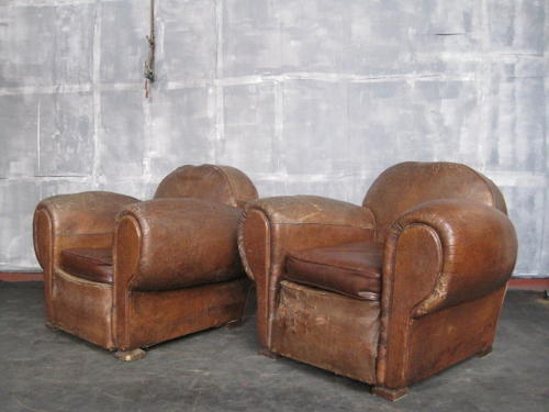 A pair of vintage leather armchairs