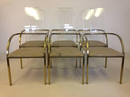 A set of six lucite and gold lacquer dining chairs