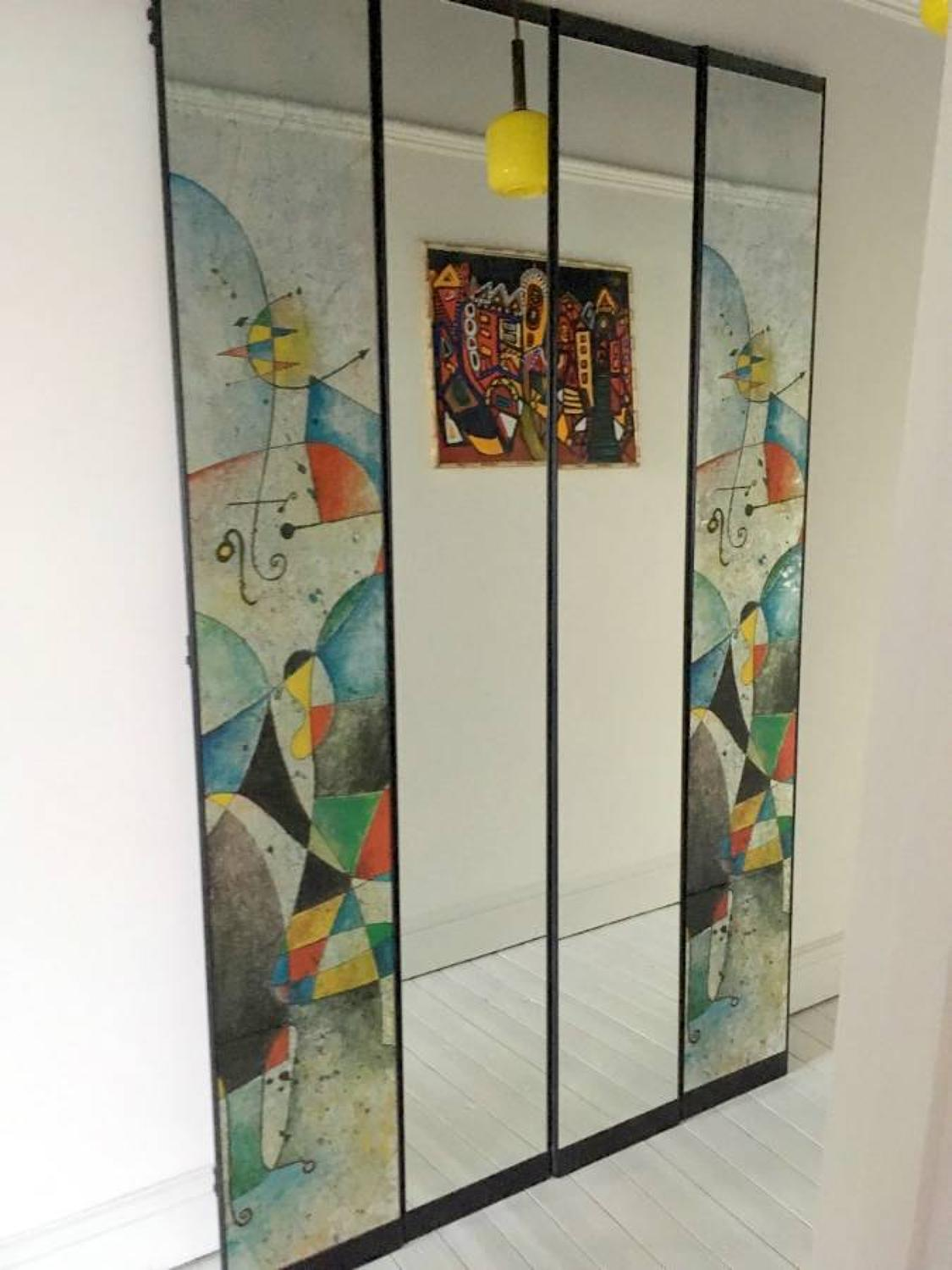 Four part mirror with Joan Miro style print
