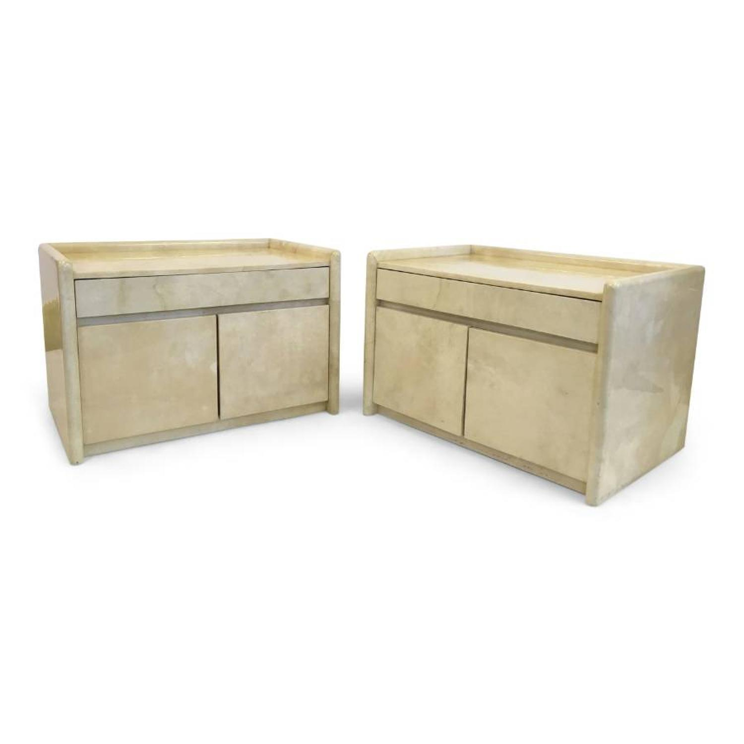 A pair of large lacquered parchment bedside tables