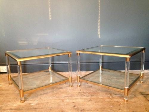 A pair of gilt brass and lucite side tables