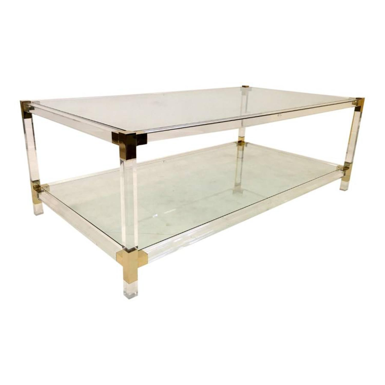 A two tier lucite and gilt metal coffee table