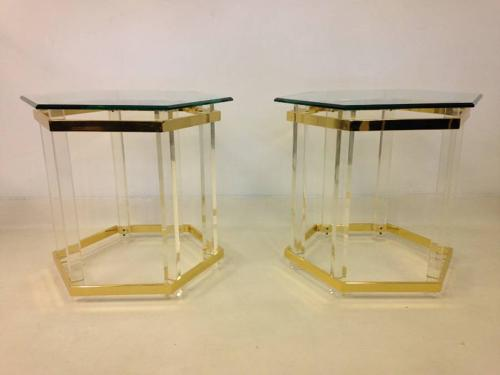 A pair of lucite side tables