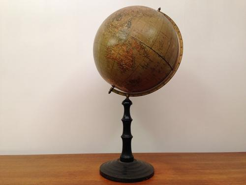 Vintage  globe on turned ebonised stand