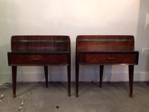 A pair of rosewood bedside tables