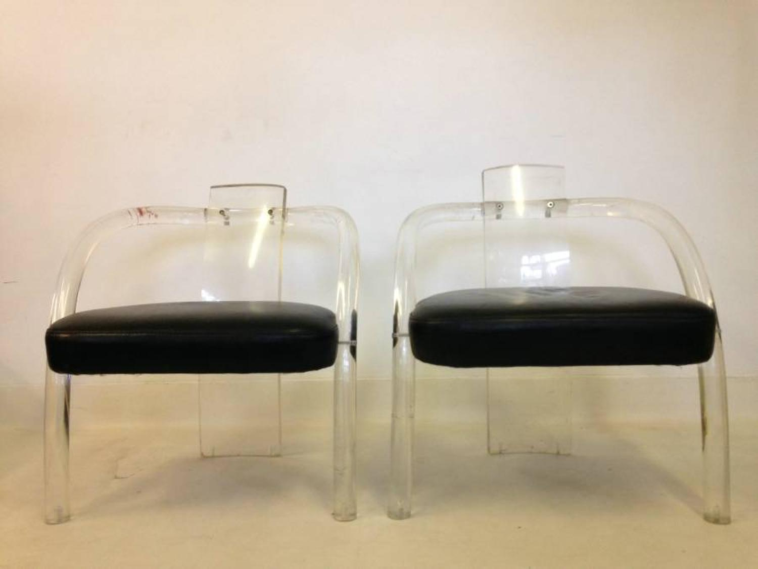 A pair of lucite armchairs by Charles Hollis Jones
