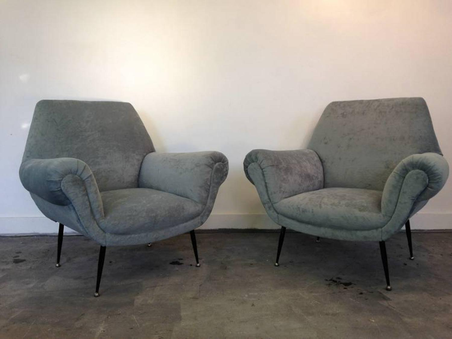 A pair of Italian 1950s armchairs