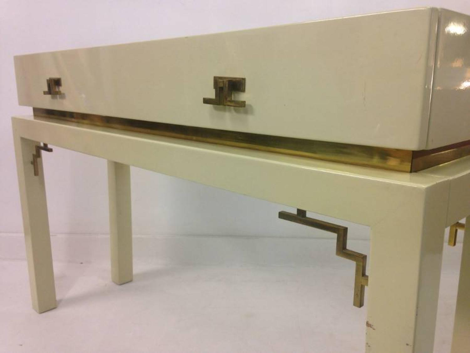 Lacquered wood and brass console table