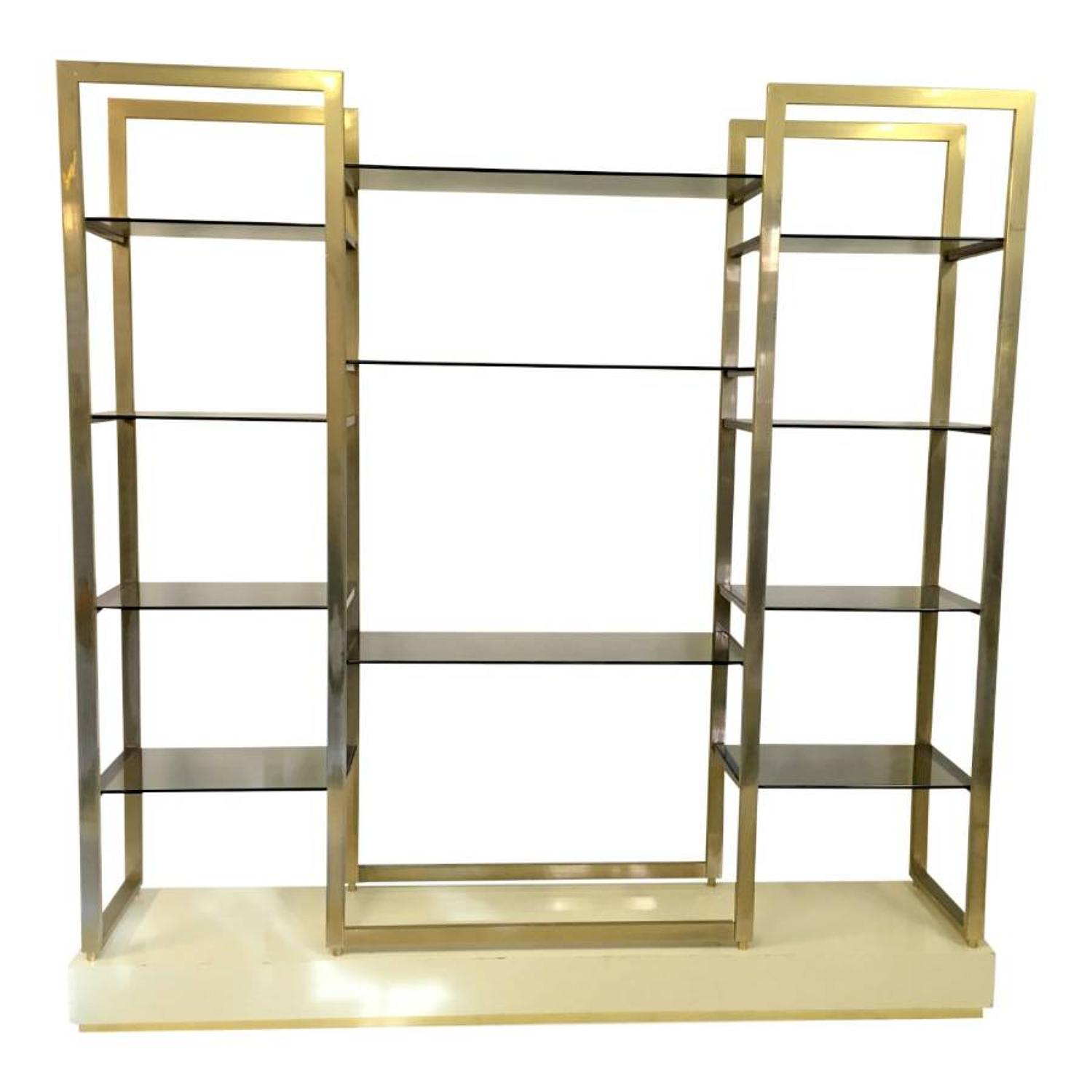 Gilt metal etagere on lacquered wood and brass base