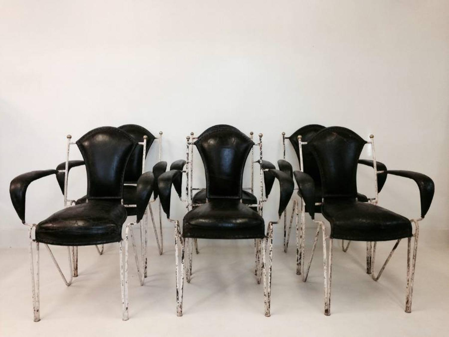 A set of six iron, leather and brass chairs