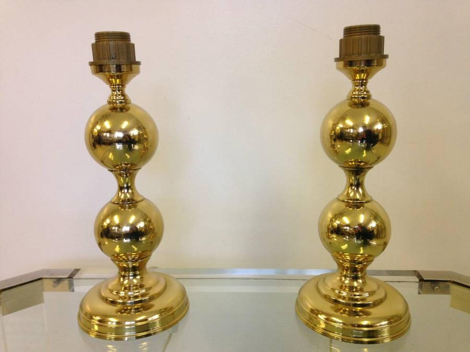 A pair of gold lacquered lamps