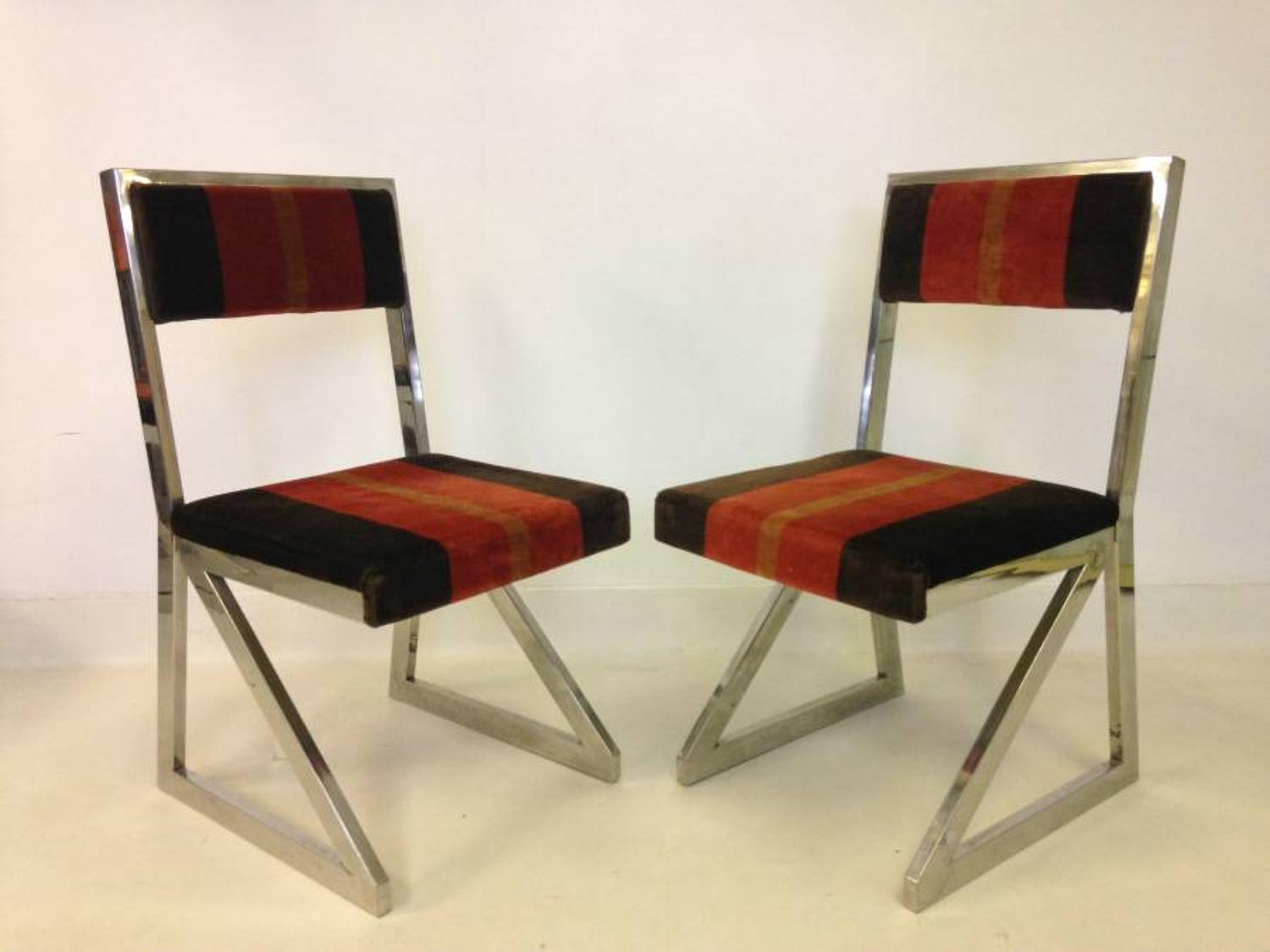 A set of six chromed cantilevered dining chairs