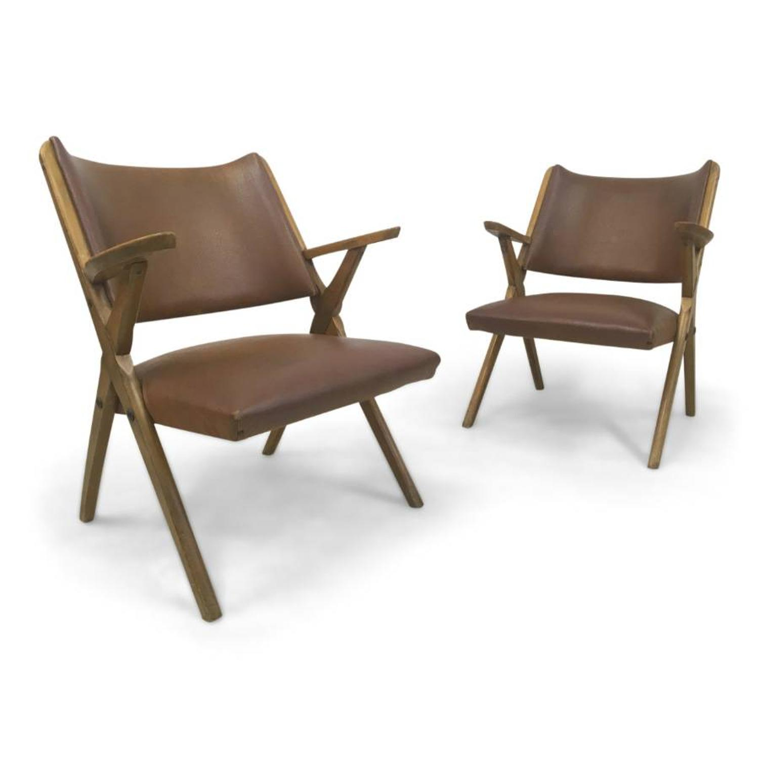 A pair of Italian wooden armchairs