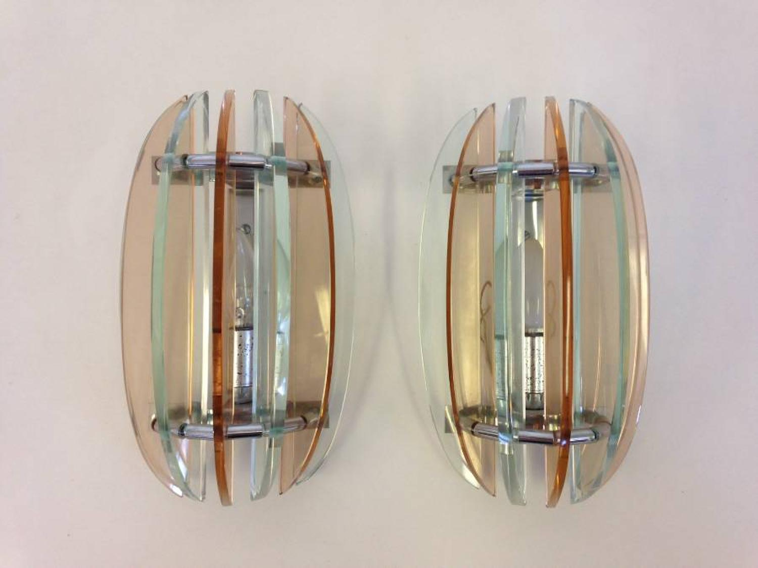 A pair of coloured glass wall lights