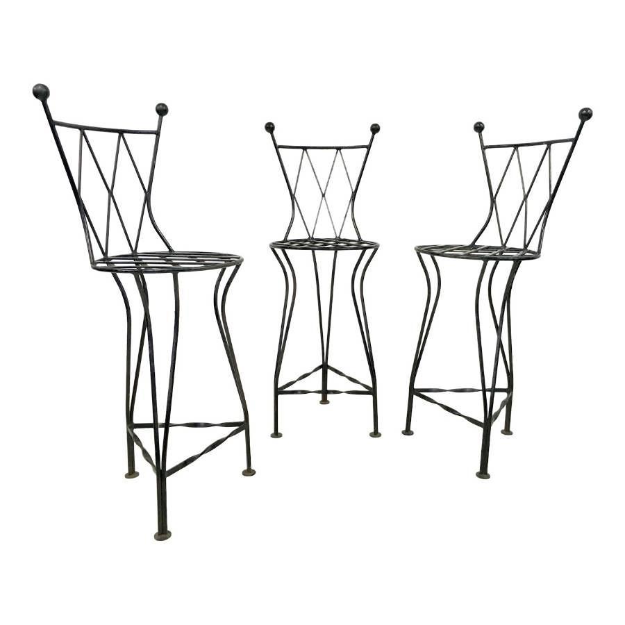A set of three iron bar stools