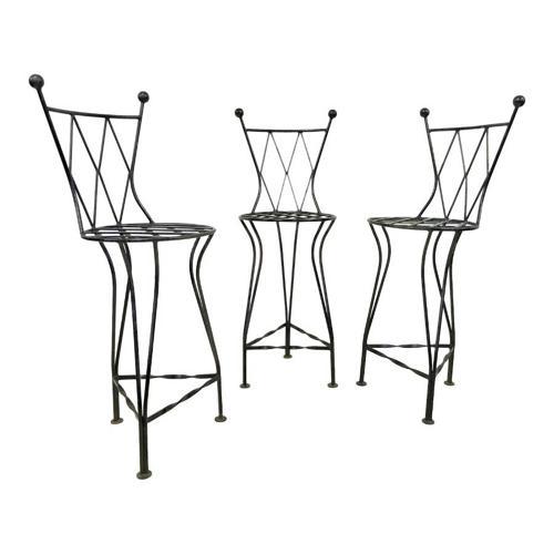 A set of three iron bar stools