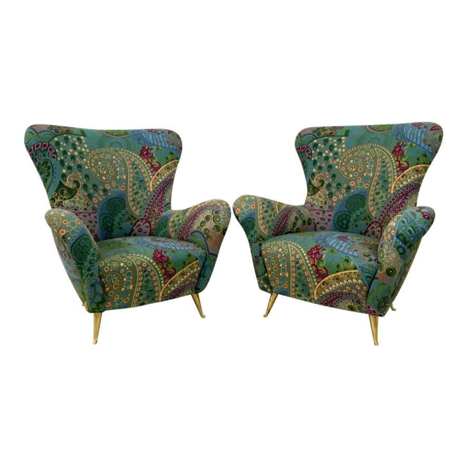 A pair of 1950s Italian armchairs with brass legs
