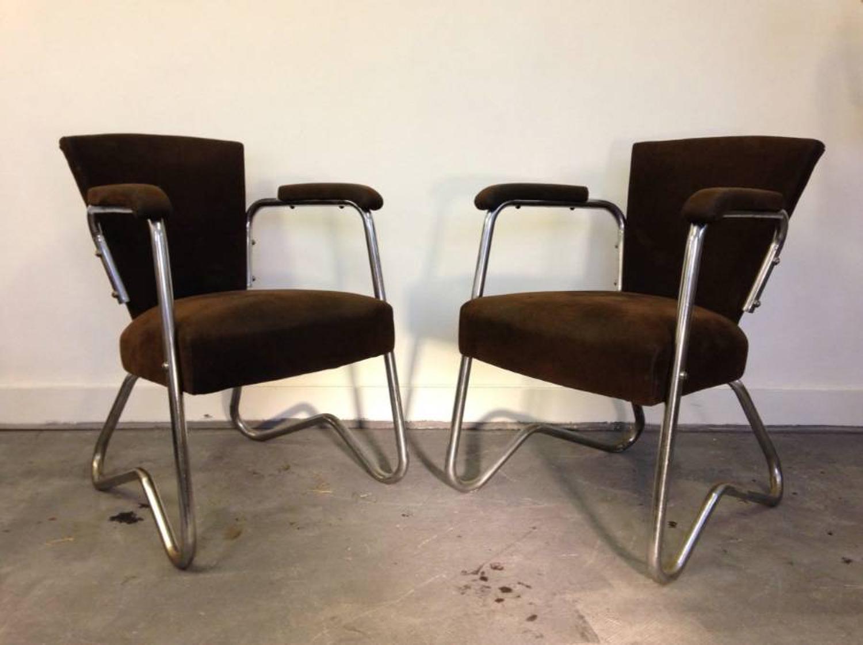 A pair of tubular steel armchairs