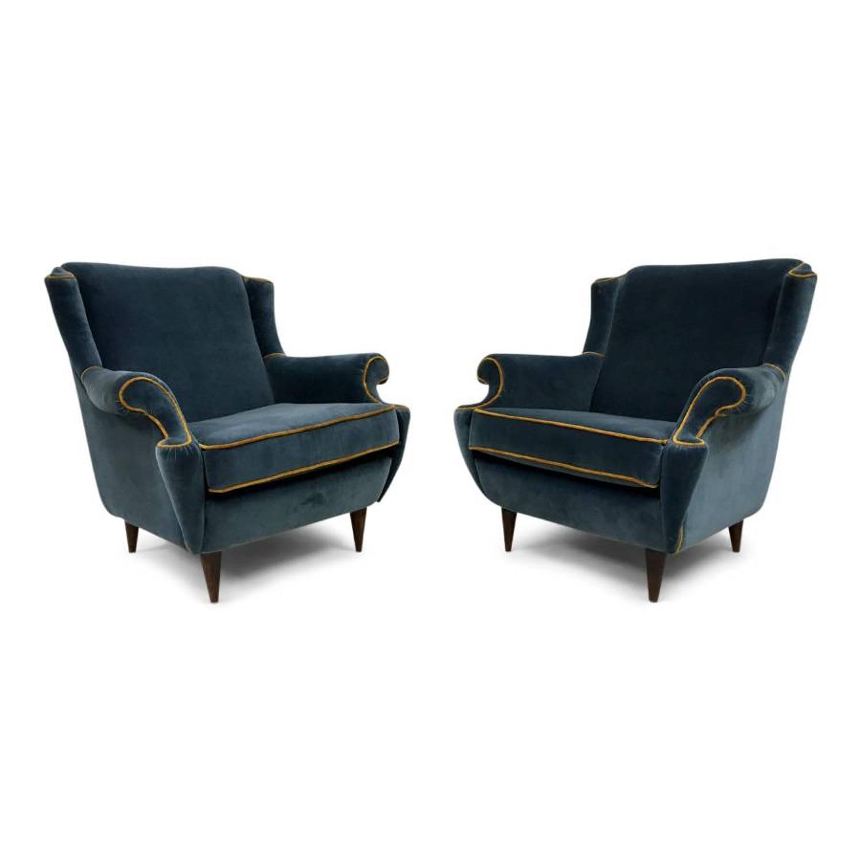 A pair of 1950s Italian armchairs in blue velvet