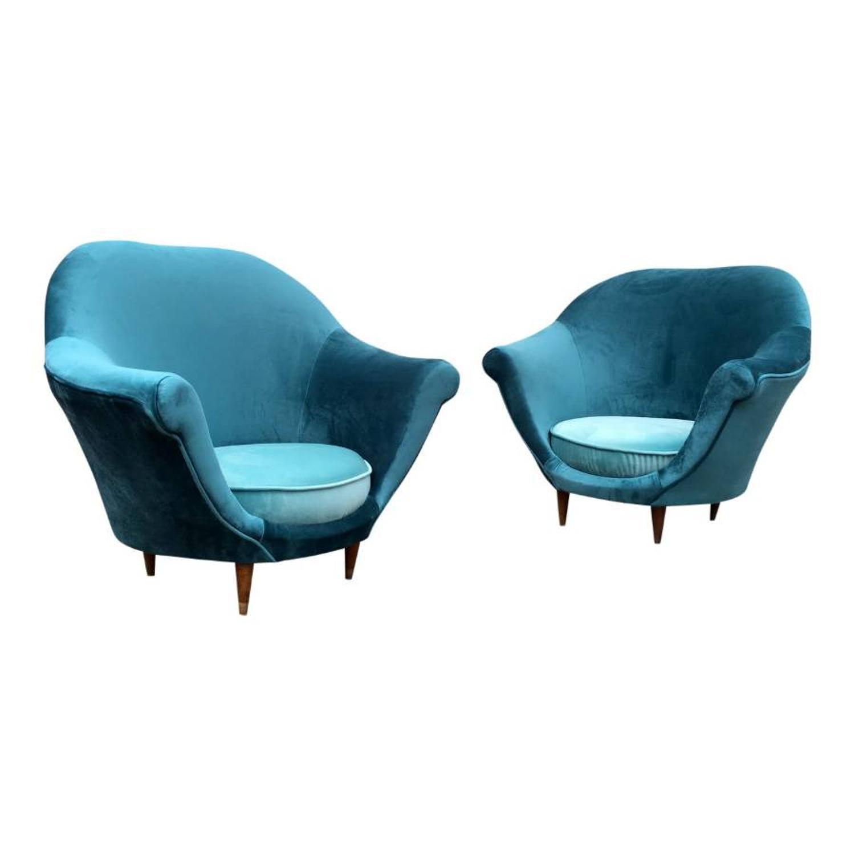 A pair of 1950s Italian tub armchairs