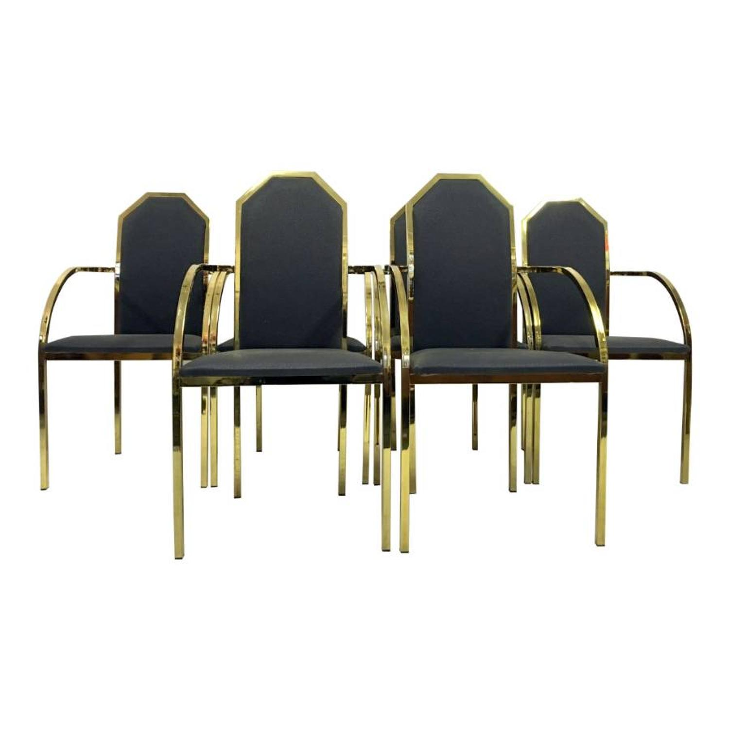 A set of six brass dining armchairs