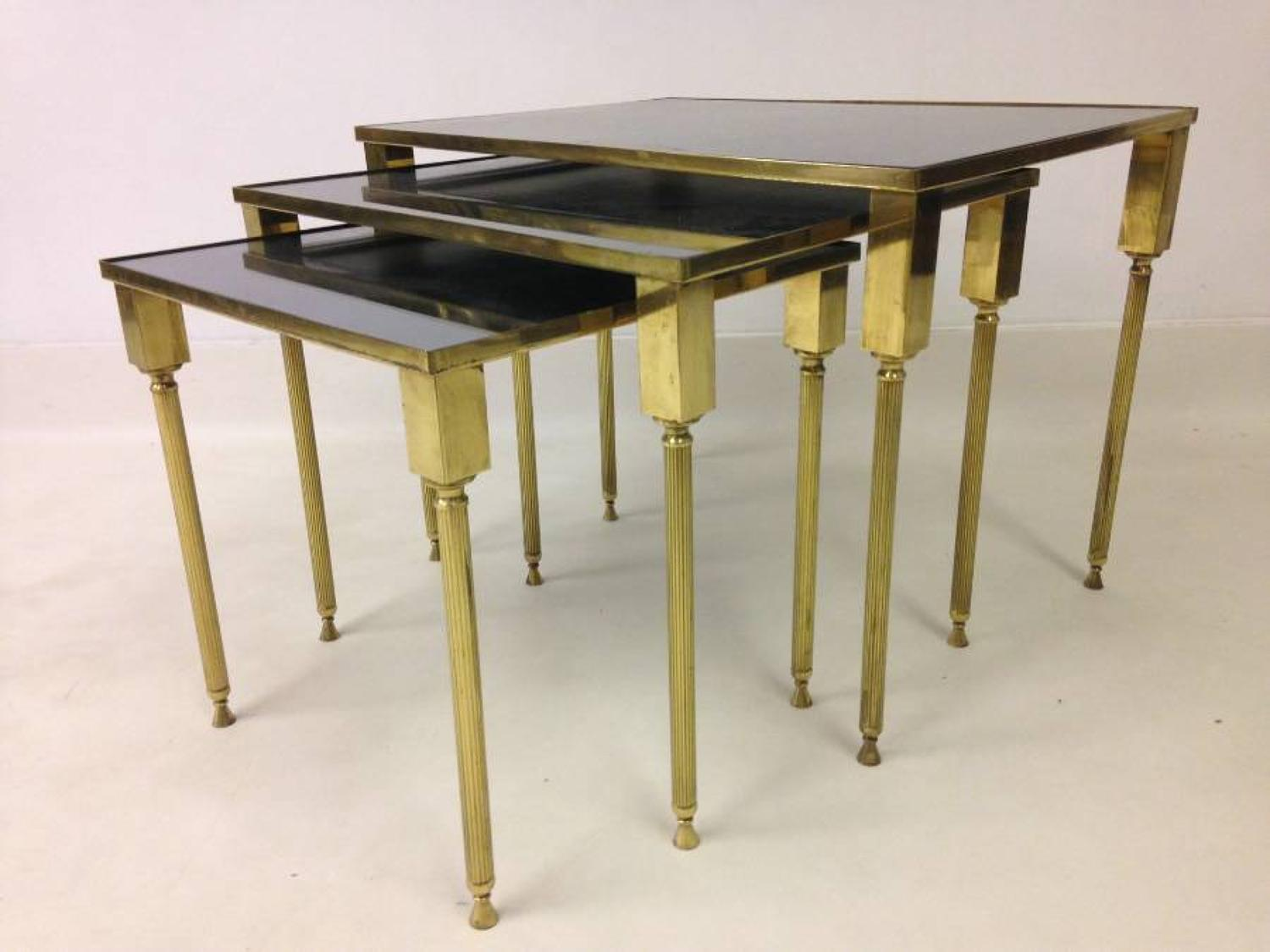 Gilt brass and black mirror nest of tables