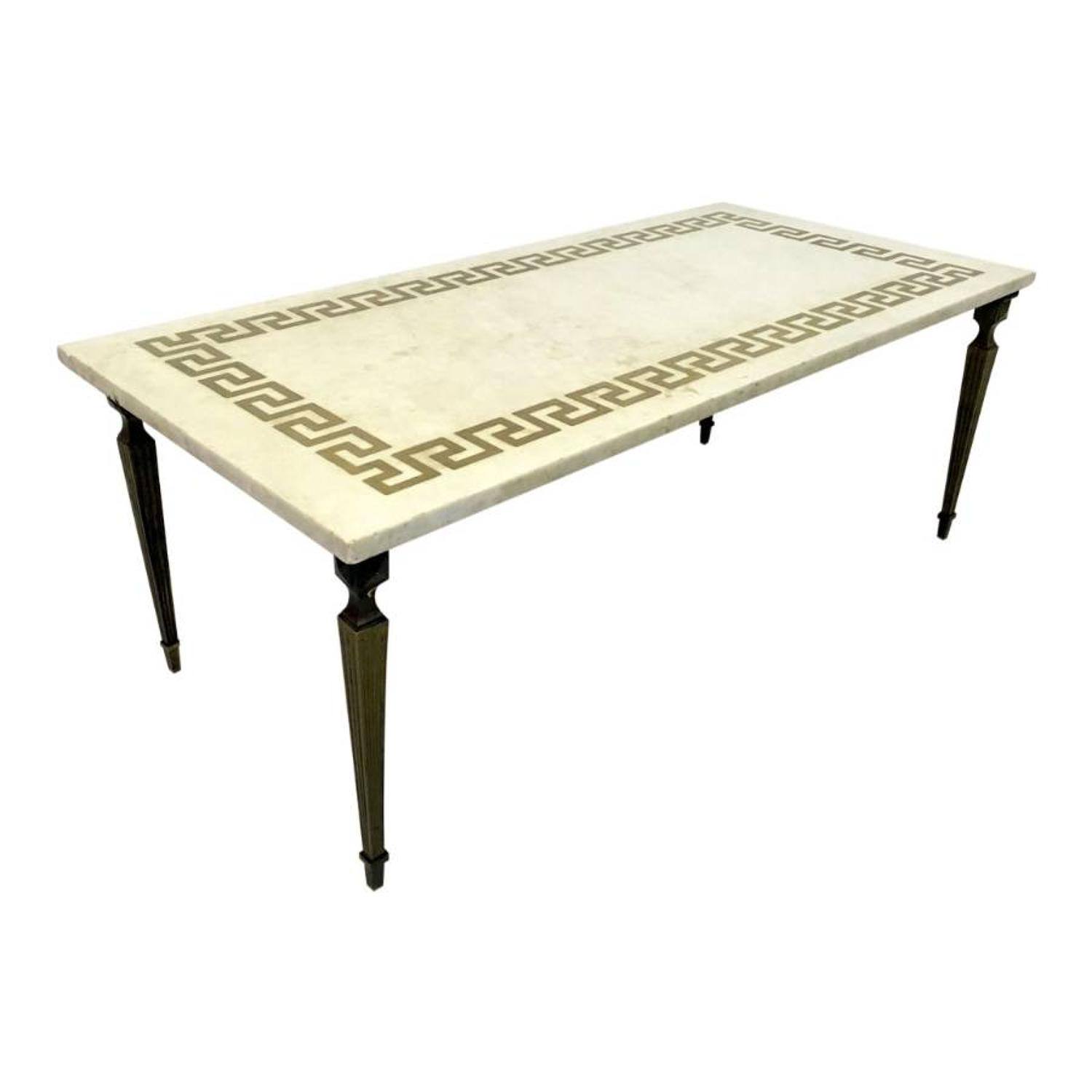 White marble and brass coffee table with inlay