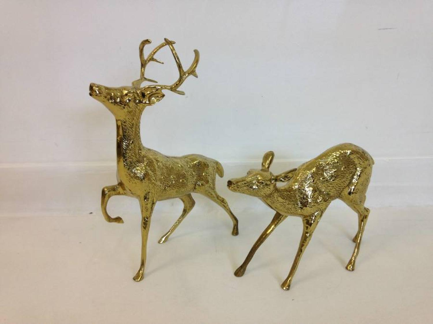 A pair of vintage brass reindeers