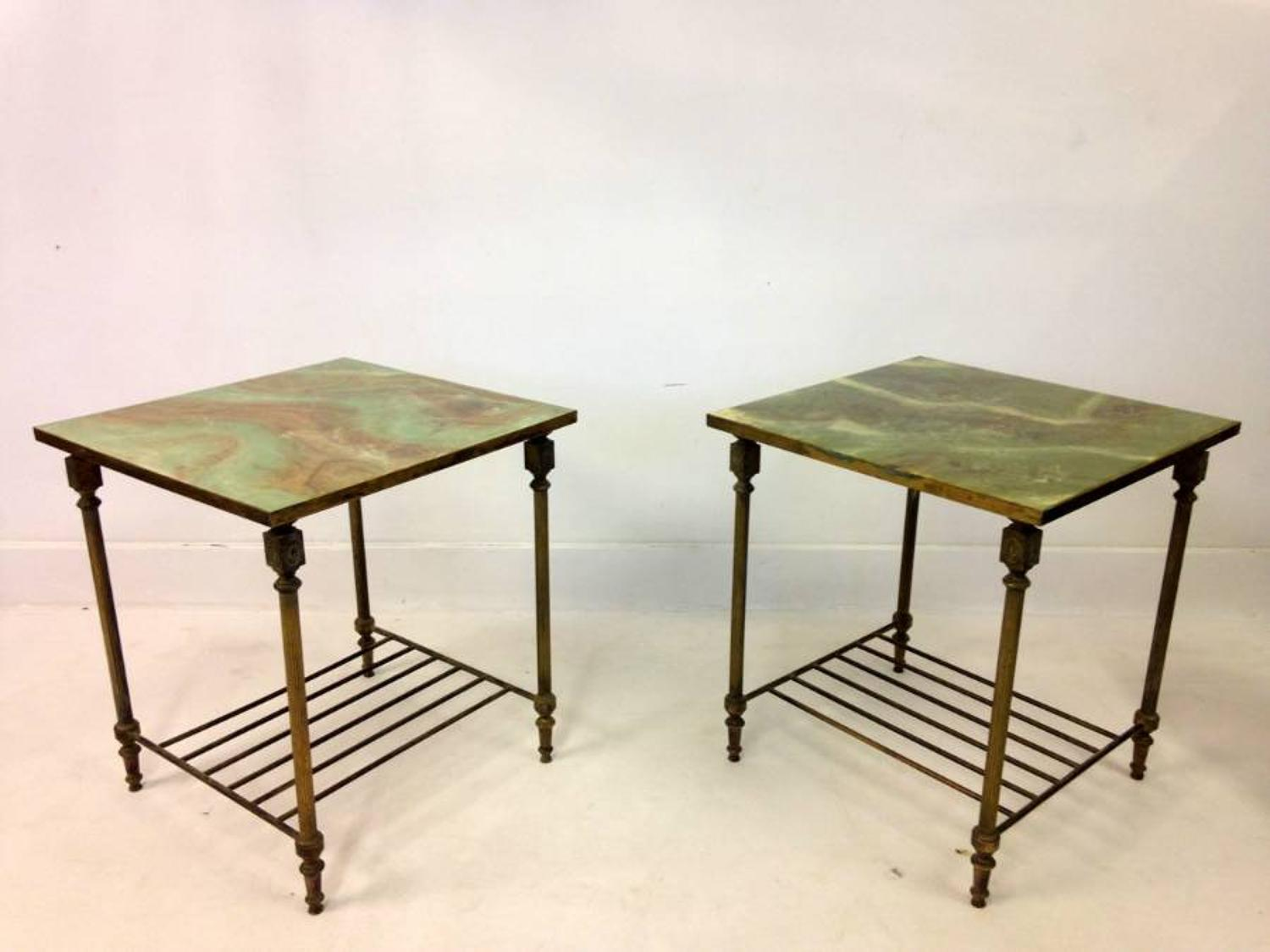 A pair of brass and faux onyx side tables