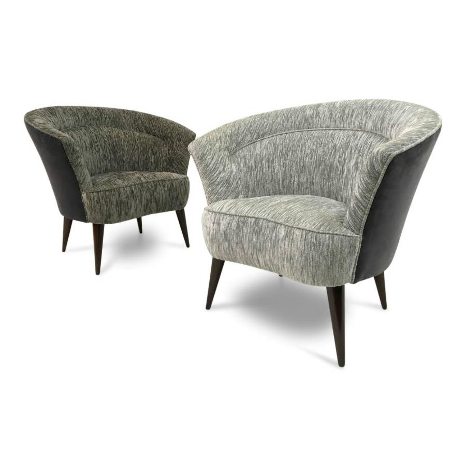 A pair of 1950s Italian tub armchairs